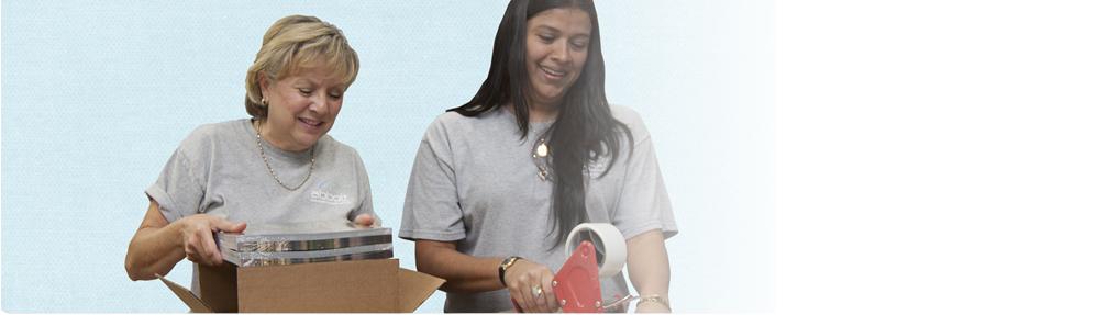 Abbott employees packing shipment